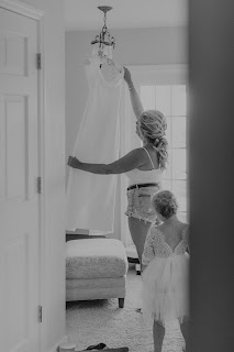 Bride and flower girl getting ready candid moments