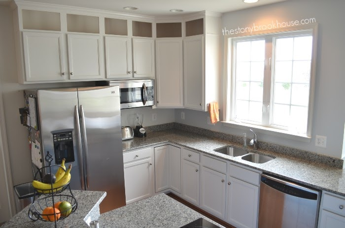 White painted kitchen cabinets sink side