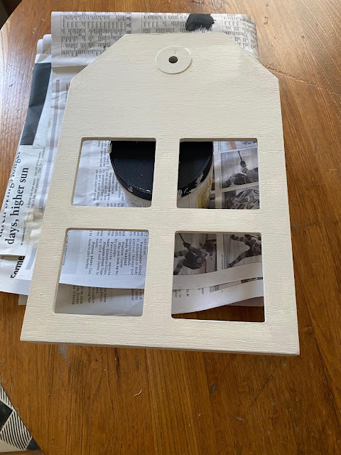 Photo of repainted tag shaped collage frame