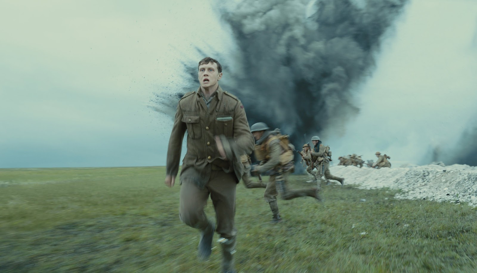 world war 1 soldier running away from a explosion in an open field for blog post about movie 1917