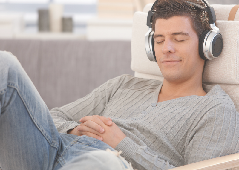 Man relaxing with headphones in a blog post about five easy ways to beat procrastination.