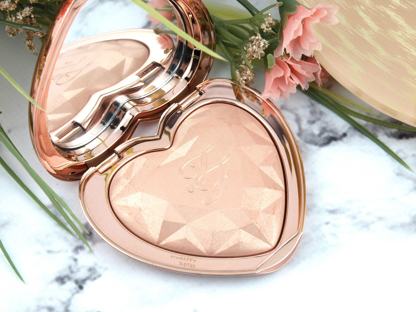 "Too Faced Love Light Prismatic Highlighter in ""Ray of Light"": Review and Swatches"
