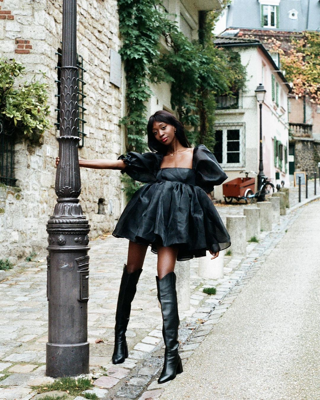 Black tulle dress and long black boots