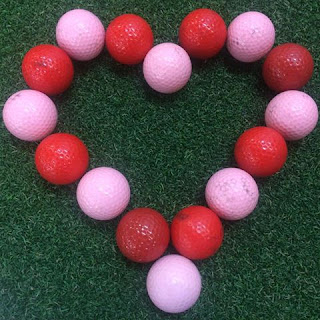 Incorrectly guess the number of golf balls used to create this Valentine and you may win! Photo by Subpar Miniature Golf