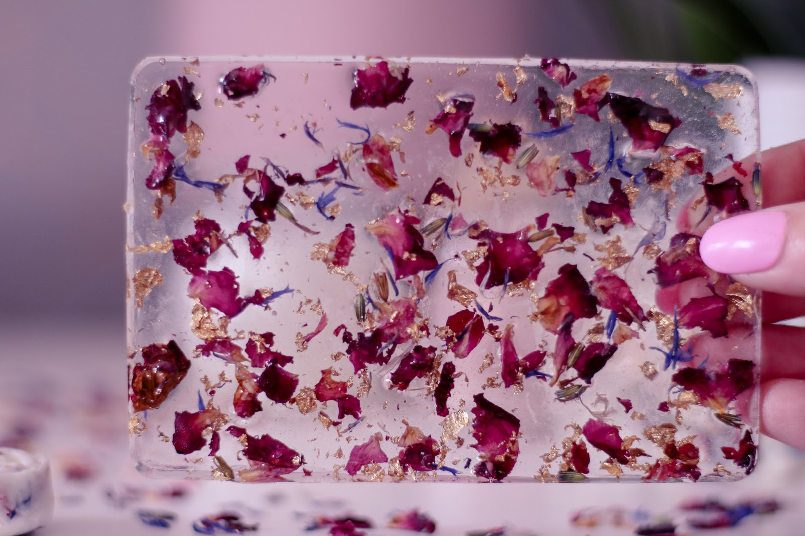 Close up photo of the resin tray with flower petals in it from Zi beauty