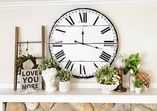 mantel with cement bowls and large clock
