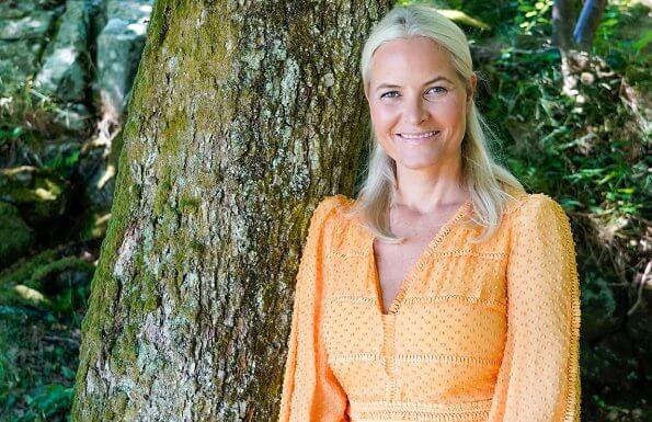 Crown Princess Mette-Marit of Norway turned 47. Princess Ingrid Alexandra and Prince Sverre Magnus. tangerine color eyelet lace dress