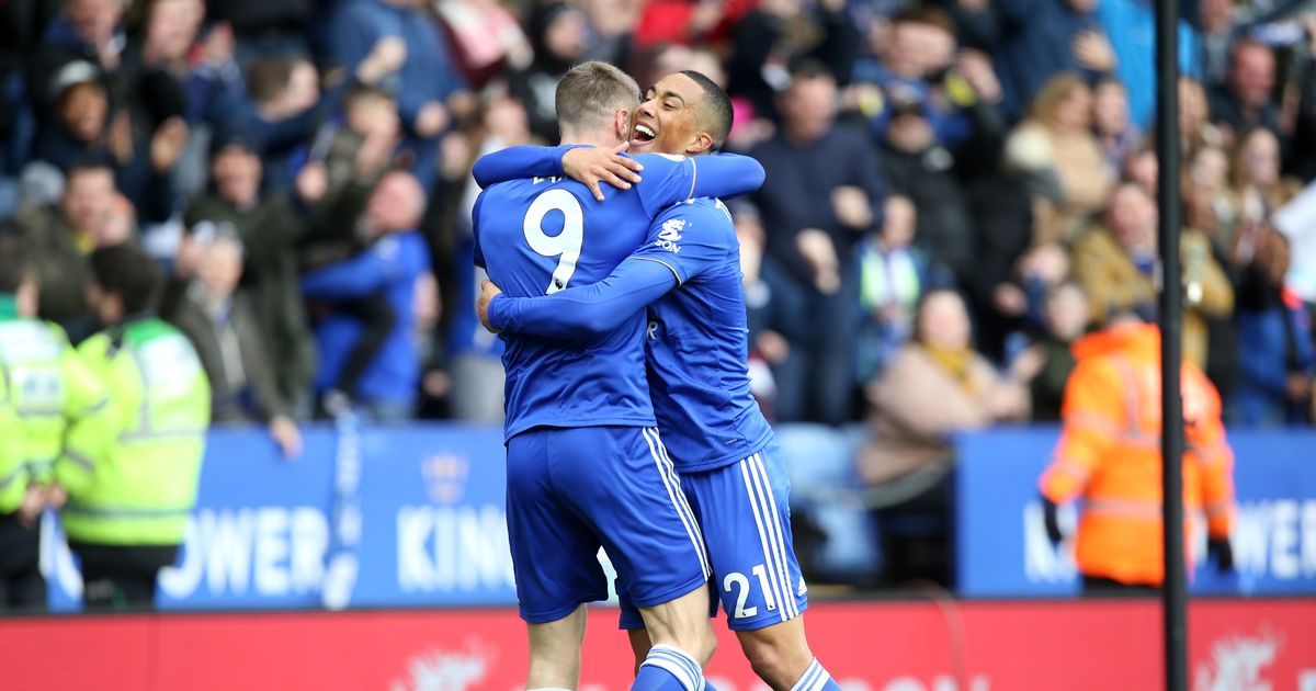 Leicester City players Jamie Vardy and Youri Tielemens embrace