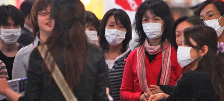 Passengers wear face masks at Beijing Capital International Airport.