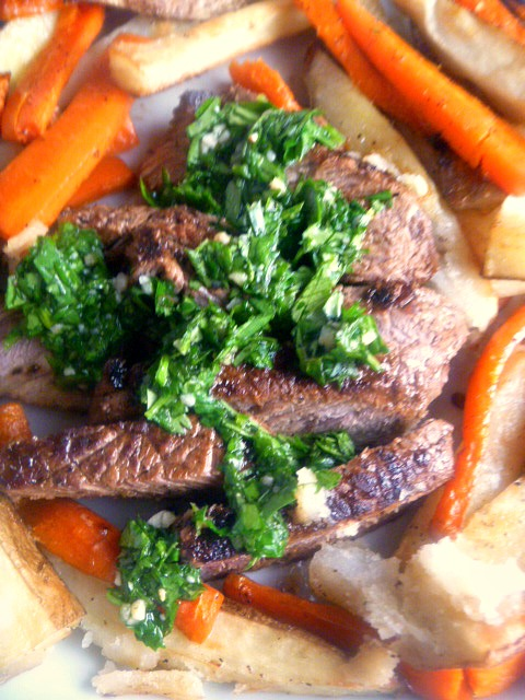 Juicy steaks are topped with a fresh herb salsa and served with roasted potatoes & carrots for a date worthy dinner! - Slice of Southern