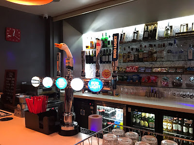 hotel bar with straws, beer pumps, bottles etc