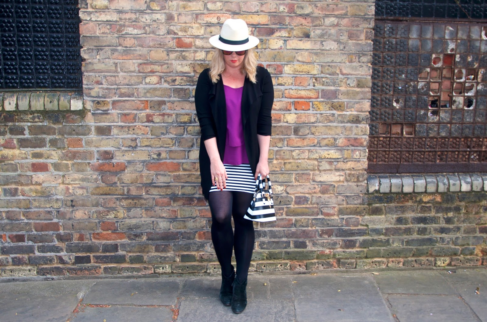 panama straw hat, pink top, waterfall cardigan and stripes