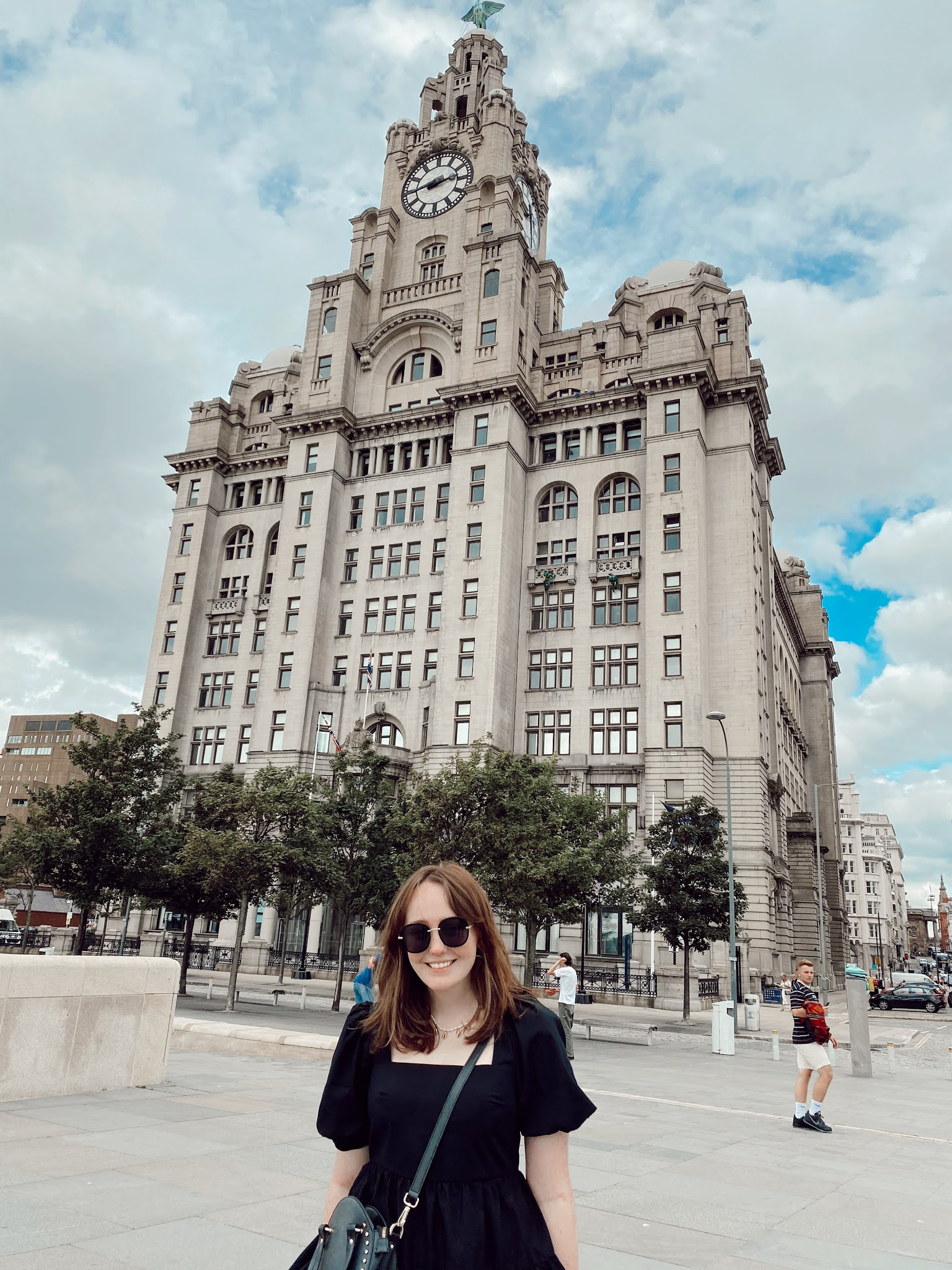 Liverpool based blogger stands in front of Liverbuilding along Liverpool waterfront