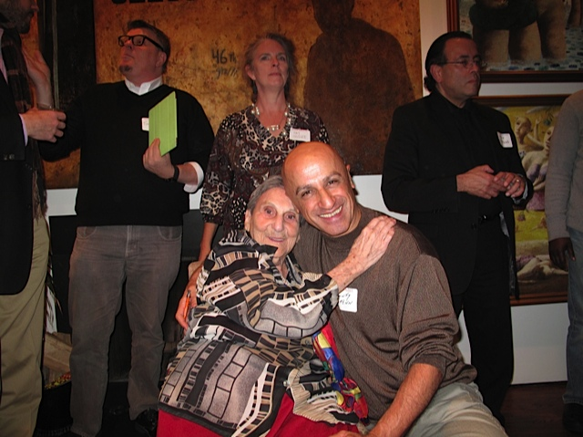 Circa 2011 - This photo was taken in 2011 at the home of a DMV art collector who threw a nice book opening party for my 100 Artists of Washington, DC book.  In the pic's background we see Andrew Wodzianski, Tim Tate, Pat Goslee, me and Victor Ekpuk's arm. In the foreground, Chawky Frenn is hugging the late, great Lida Moser!