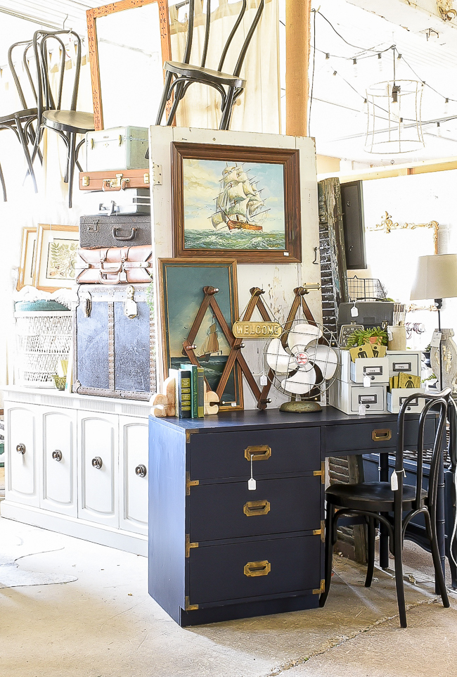 Coastal blue campaign desk paired with industrial vintage finds