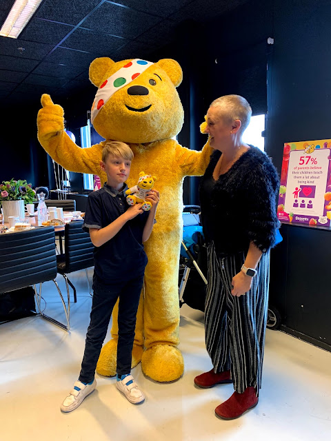 madmumofof7 and son with Pudsey Bear mascot