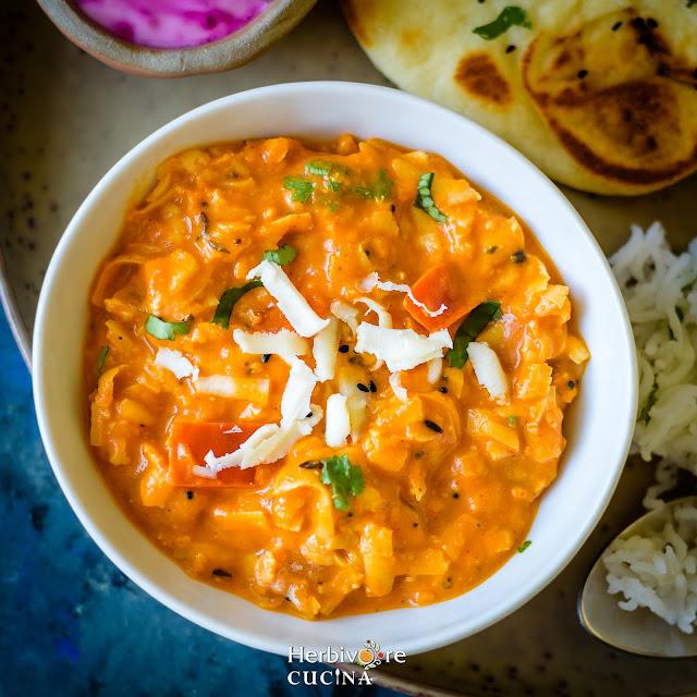 Bowl of shredded paneer curry, Akbari Paneer