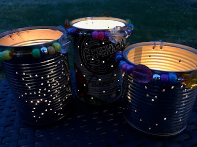 Tin can lanterns with candles at night