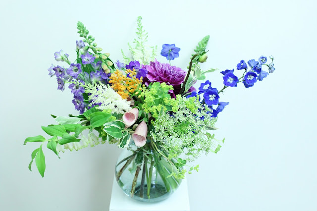 summer vase by periwinkle flowers