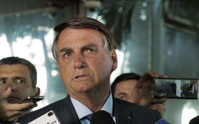 Bolsonaro diz  a franceses que no Brasil, cloroquina tem 100% de cura
