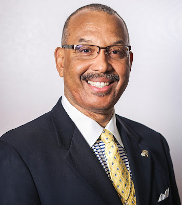 photo of reverend dr. warren stewart smiling