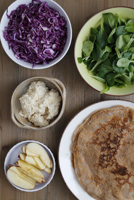 A selection of plates with crepes and fillings