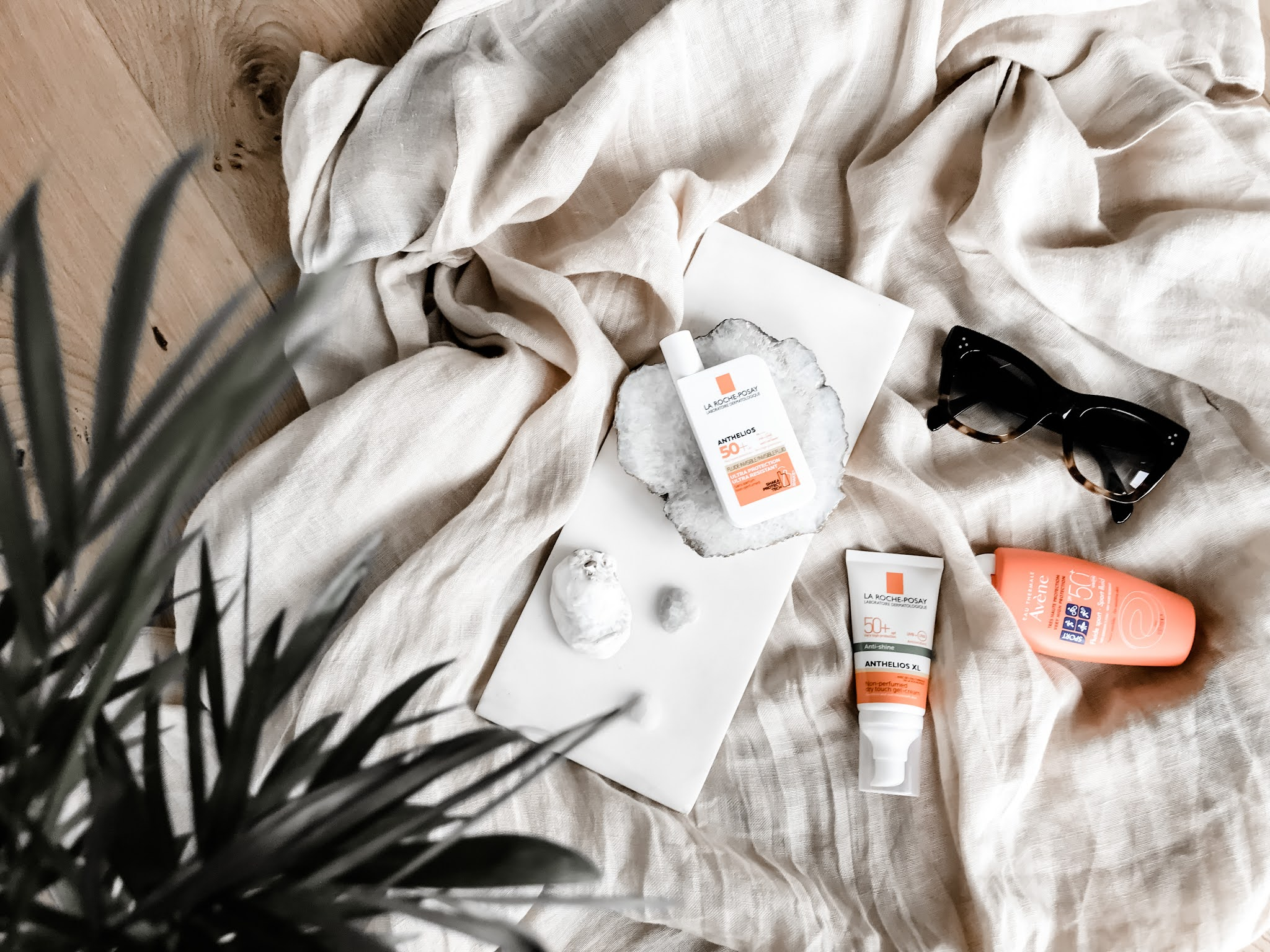 Flatlay with Sunscreen by Avene and La Roche Posay
