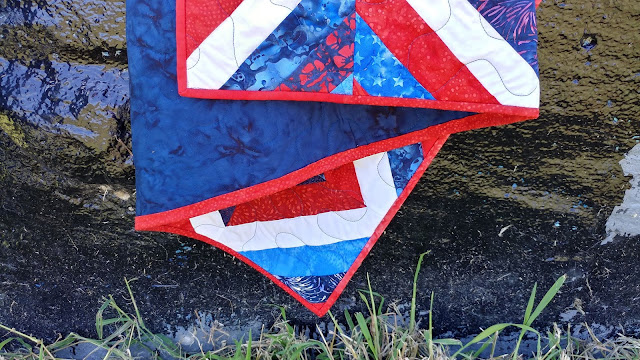Red, white, and blue batik string quilt
