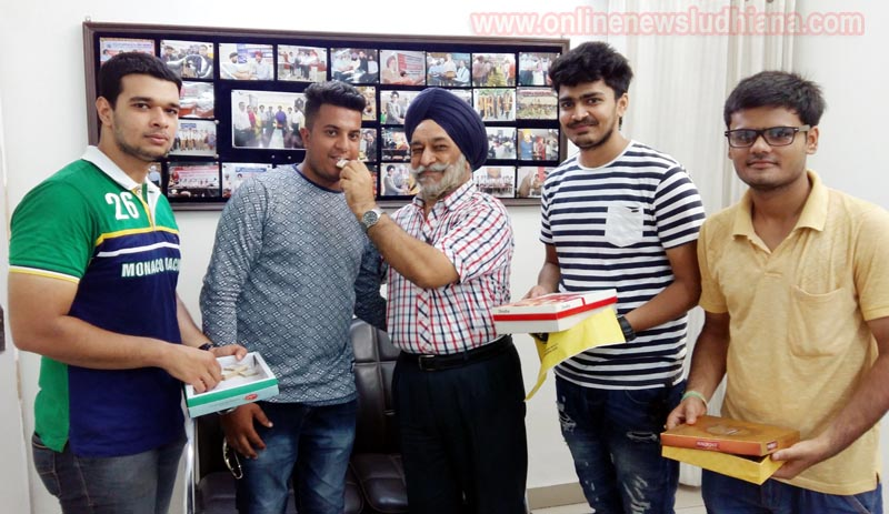 Director of GGNIMT Prof. Manjit Singh Chhabra with toppers