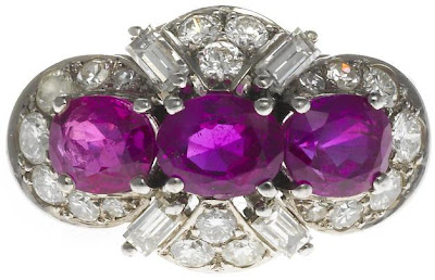 Pink sapphire and diamond ring by Schilling. Via Diamonds in the Library.