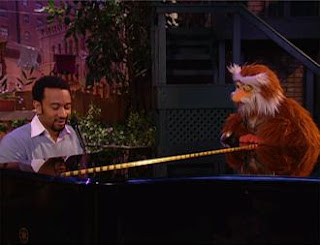 """John Legend sings """"It Feels Good When You Sing a Song"""" with Hoots the Owl. Sesame Street Episode 4324 Trashgiving Day season 43"""