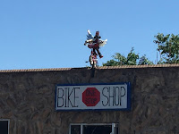bike above building at One Stop Bike Shop