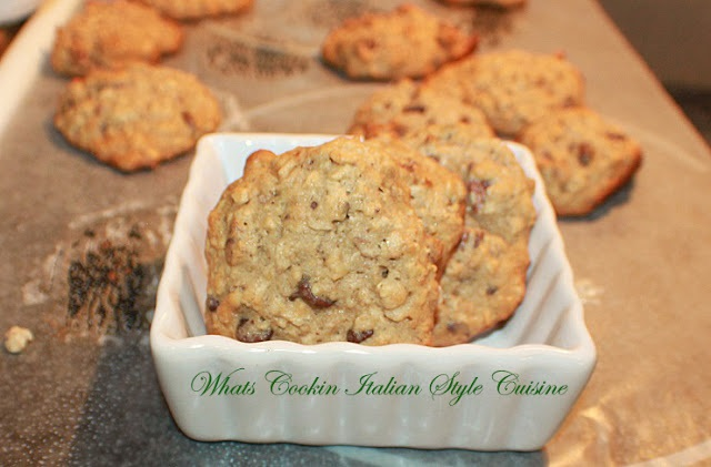banana chocolate chips cookies cooling on parchment paper and in a white square dish