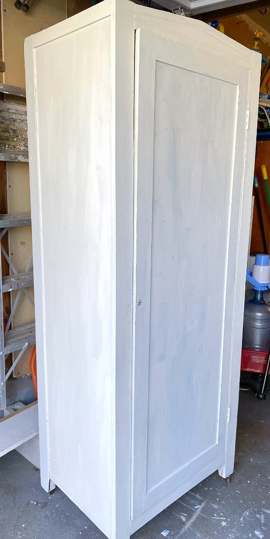 Large cupboard with first coat of white paint.