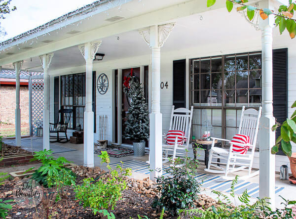 Christmas porch with red striped pillow wraps