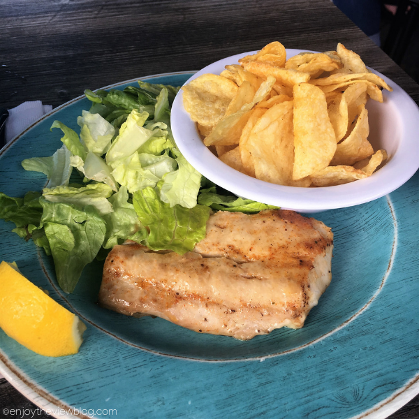 grouper with a side salad and a small bowl of kettle chips