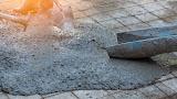 Kan je beton laten gieten over een bestaande vloer?
