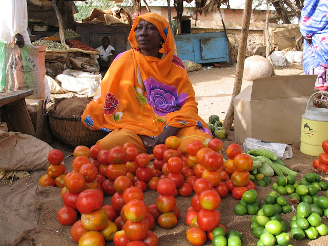 Selling vegetables for stew in Uganda