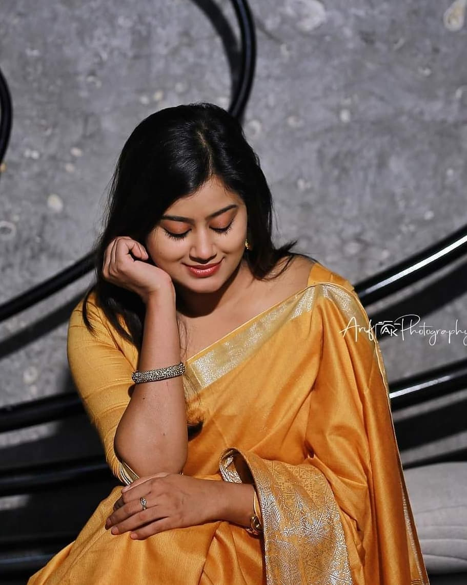 South Indian Actress Ansiba Hassan Stills in Golden Colour Saree