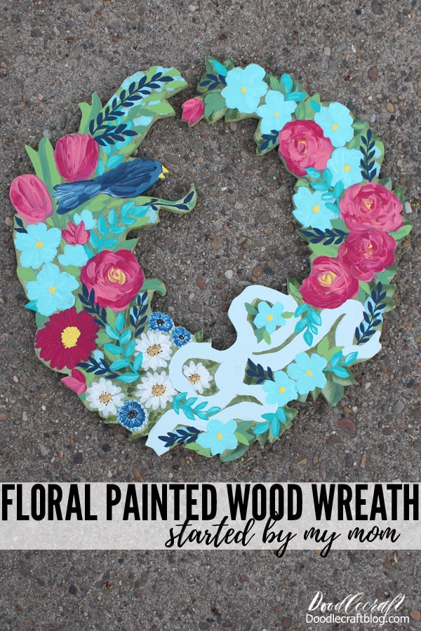 Paint bold flowers on a wooden cut out wreath using acrylic craft paints. This stunning wreath was started by my mom, so it is the perfect combination of both of us.