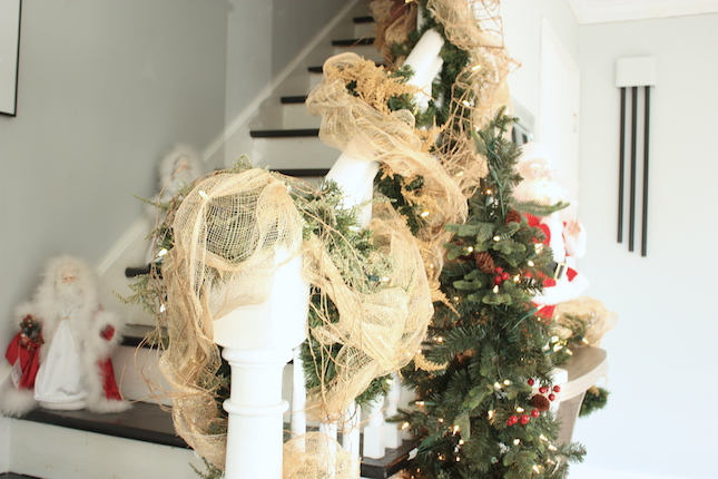 rustic green and gold christmas stair decor