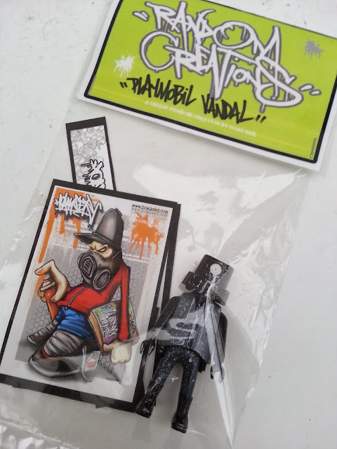 http://www.ebay.co.uk/itm/play-mobil-custom-figure-graffiti-designer-toy-and-stickers-nozzle-fatcap-art-uk-/151189641227?pt=UK_ToysGames_ActionFigures_ActionFigures_JN&hash=item23339ad80b