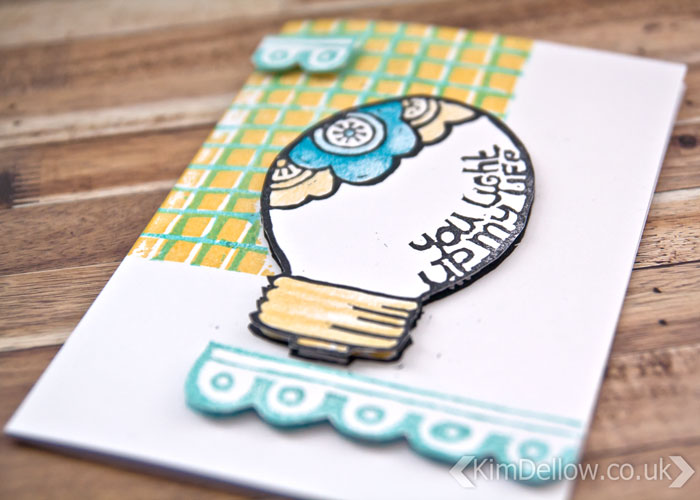 close-up of the lightbulb design card by Kim Dellow