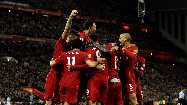 Liverpool players celebrating a goal in their 3-1 win over Manchester City in the Premier League