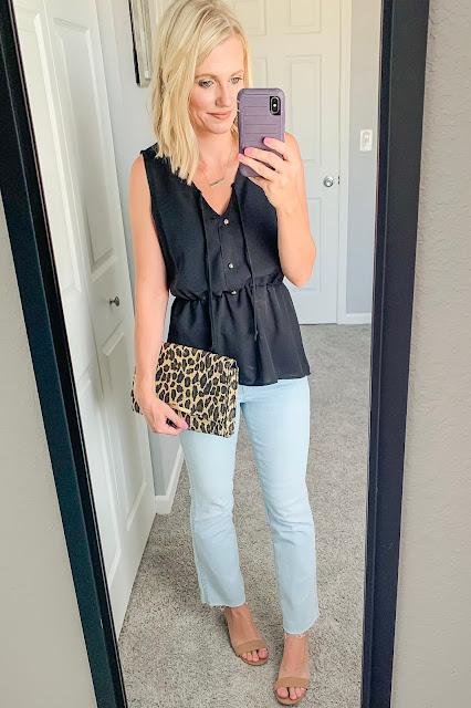 Black peplum top with cropped flair jeans and block sandals