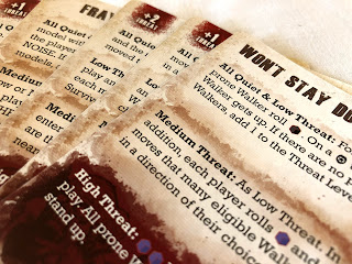 A selection of event cards from The Walking Dead: All Out War miniatures game
