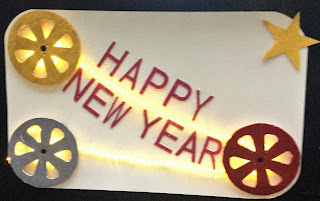Lit sign bearing words Happy New Year