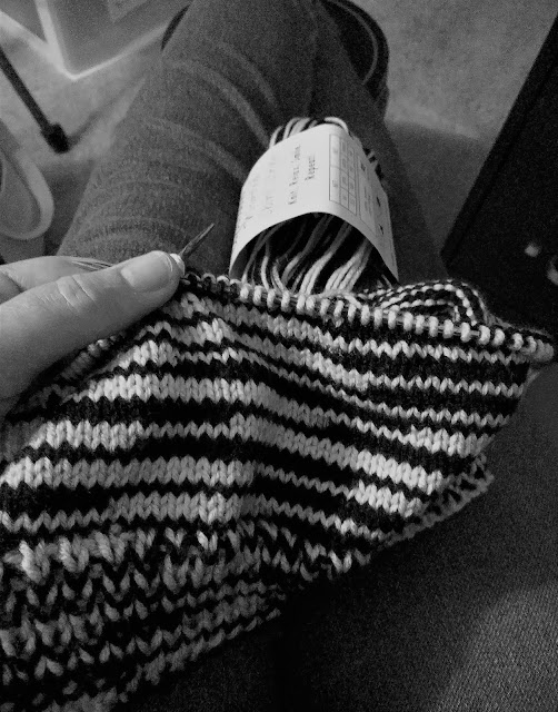 Knitting a striped hat in team colors for a Christmas gift.