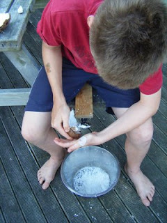 boy grating coconut