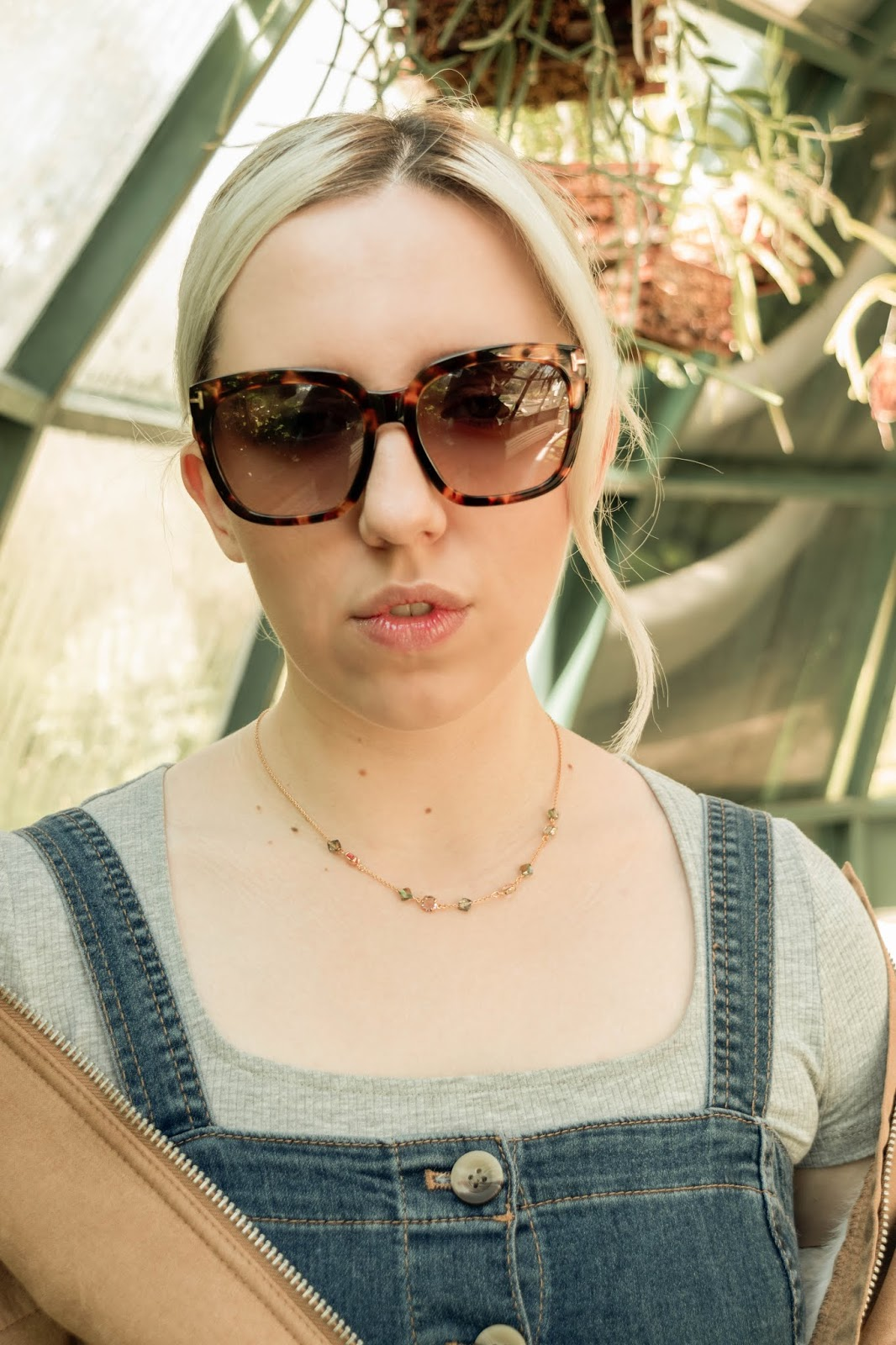 Portrait of a blonde fashion blogger Sienna Belic from Croatia wearing a crystal necklace